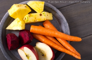 Prepping fresh organic fruits and veggies for a healthy home made juice.